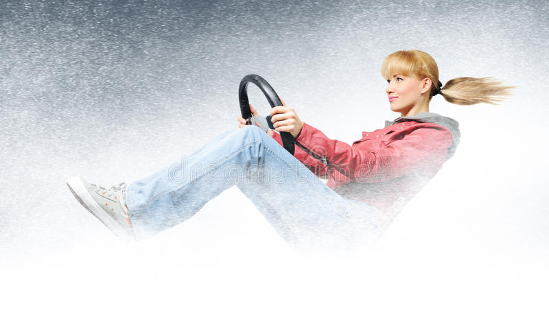 Woman car driver, concept of winter driving stock images
