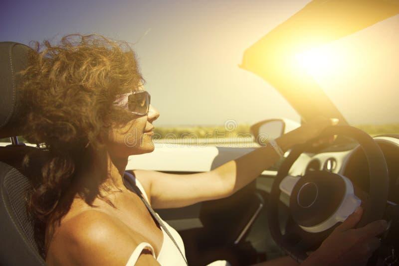 Woman in the car. stock photos