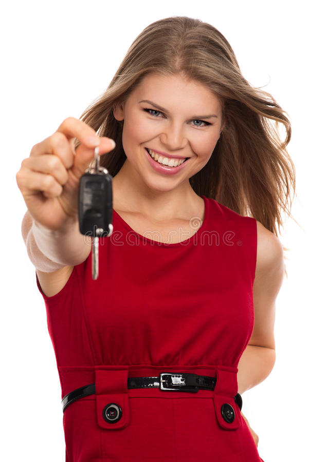 Woman with car key royalty free stock photo