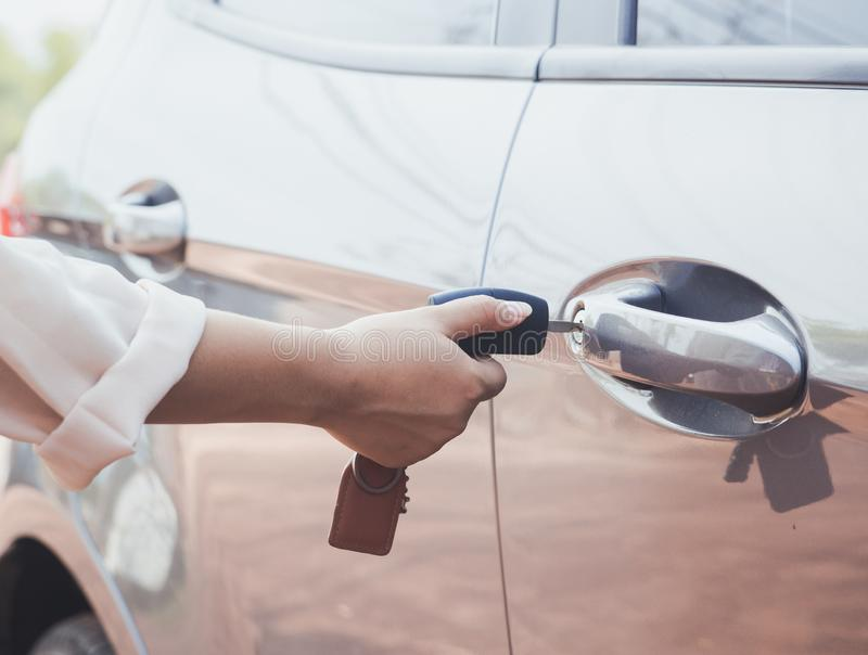 Woman with car key stock photos