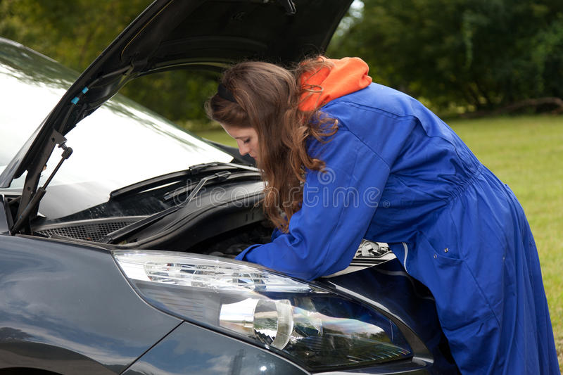 Woman car mechanic in action royalty free stock image