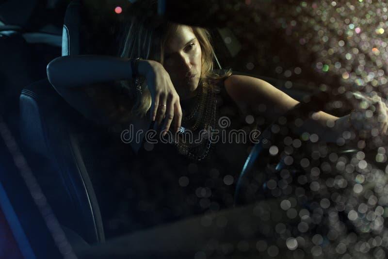 Woman in car night light stock image