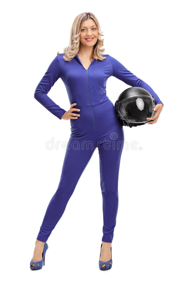 Woman car racer in a blue racing suit royalty free stock images