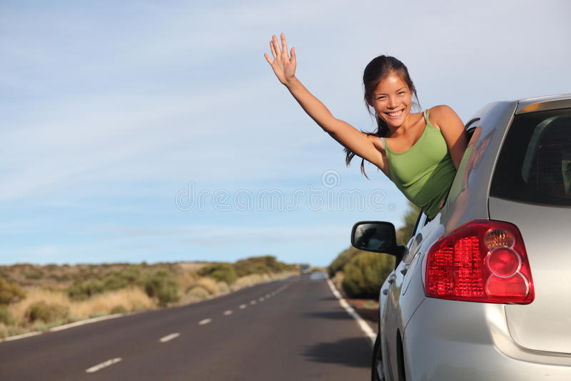 Woman in car road trip stock image