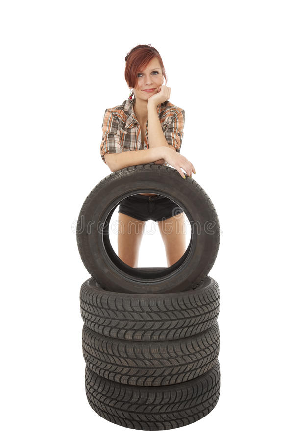 Woman With A Car Tyre Royalty Free Stock Photography