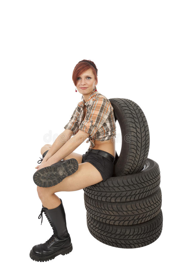 Woman On A Car Tyre Stock Images