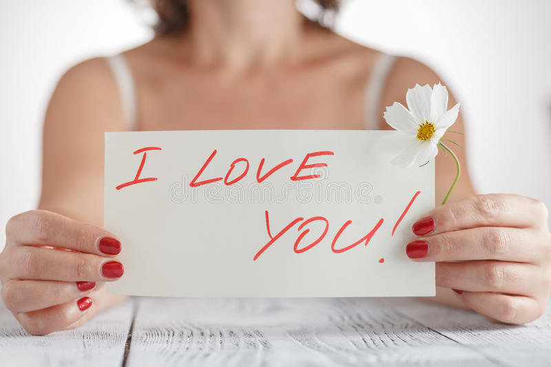 Woman with card I love You on white background royalty free stock photography
