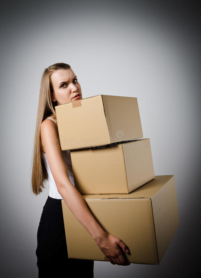 Woman and cardboards. stock image