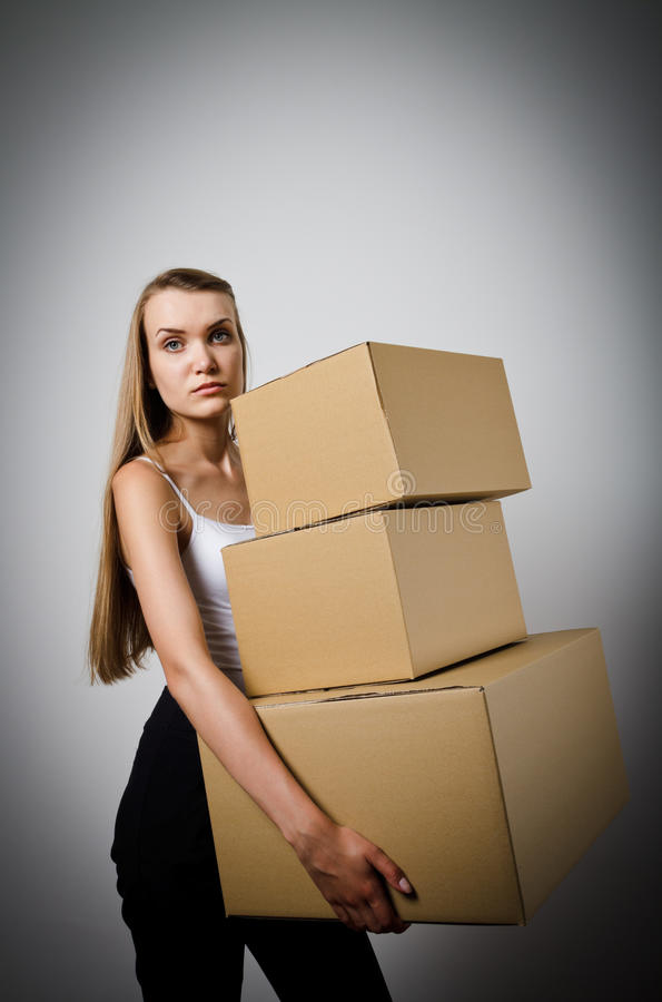 Woman and cardboards. royalty free stock photo