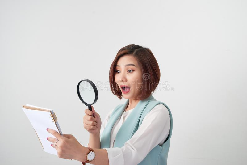 Woman carefully reading business contract with magnifying glass royalty free stock photos