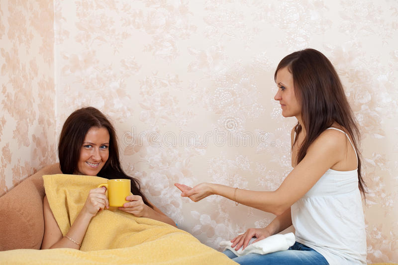 Woman cares for sick friend royalty free stock photography