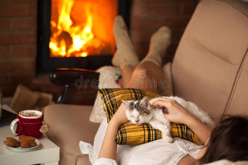 Woman caressing her new rescue kitten stock photography
