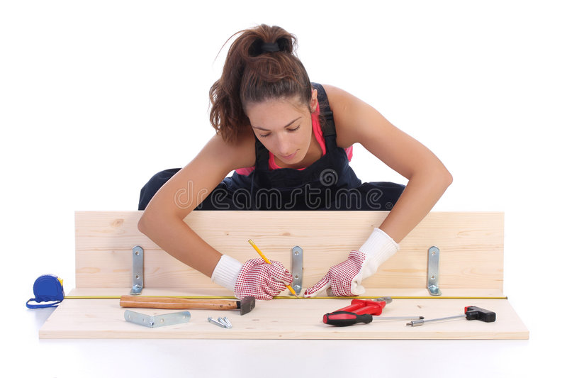 Woman carpenter at work royalty free stock images