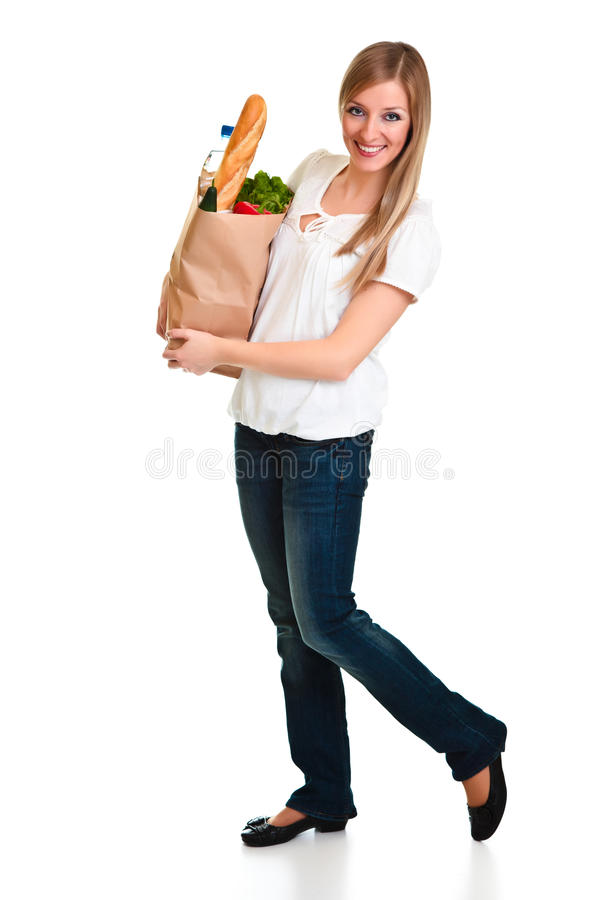 Woman carrying bag of groceries royalty free stock images