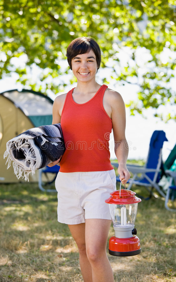 Woman Carrying Blanket And Lantern Royalty Free Stock Photography