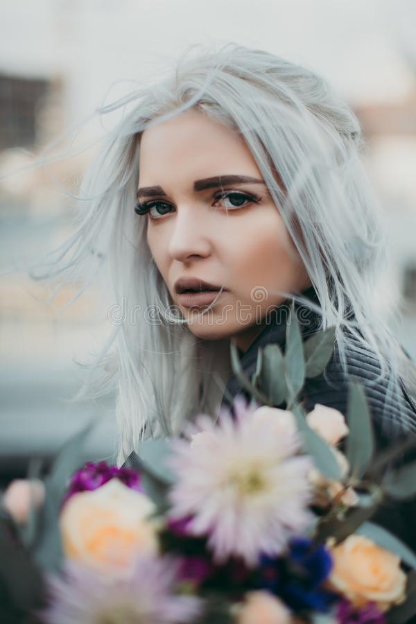 Woman Carrying Flowers Closeup Photo royalty free stock photo