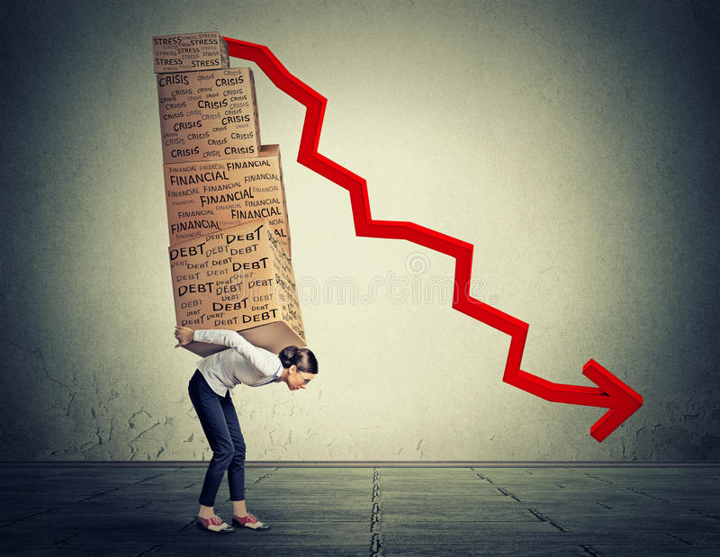 Woman carrying heavy boxes full of financial debt walking along gray wall background stock photo