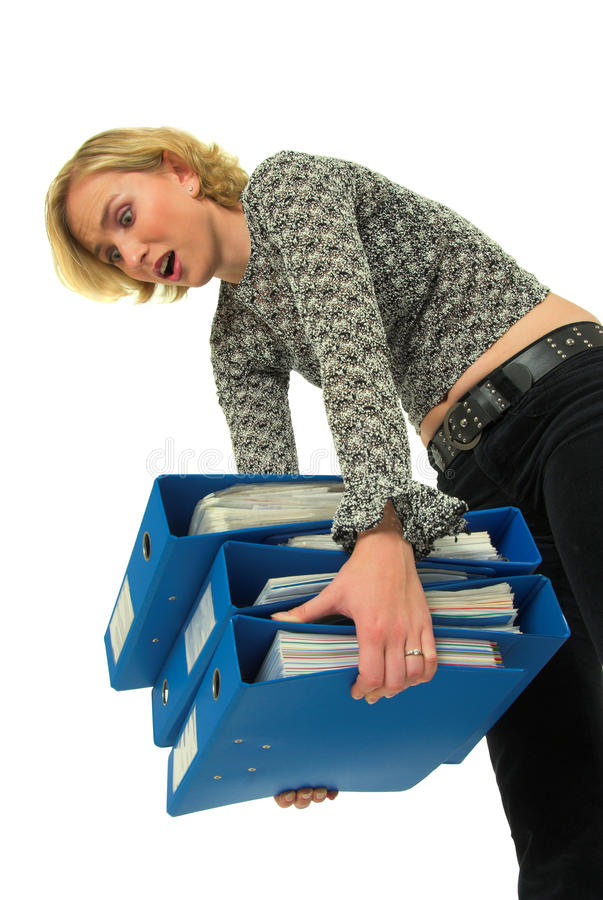 Woman carrying heavy files royalty free stock photography