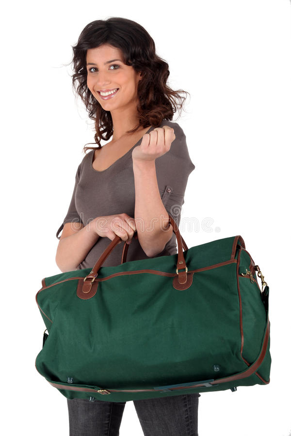 Woman carrying luggage stock images