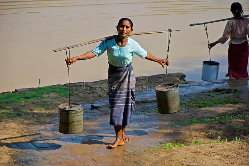Download Woman carrying water editorial stock image. Image of exotic - 25886164