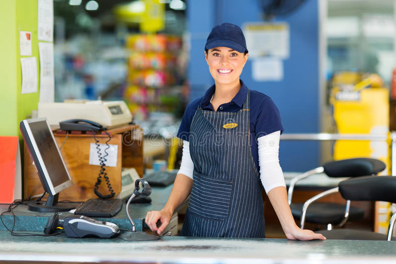 Woman cashier supermarket. Beautiful woman working as a cashier at the supermarket stock photos