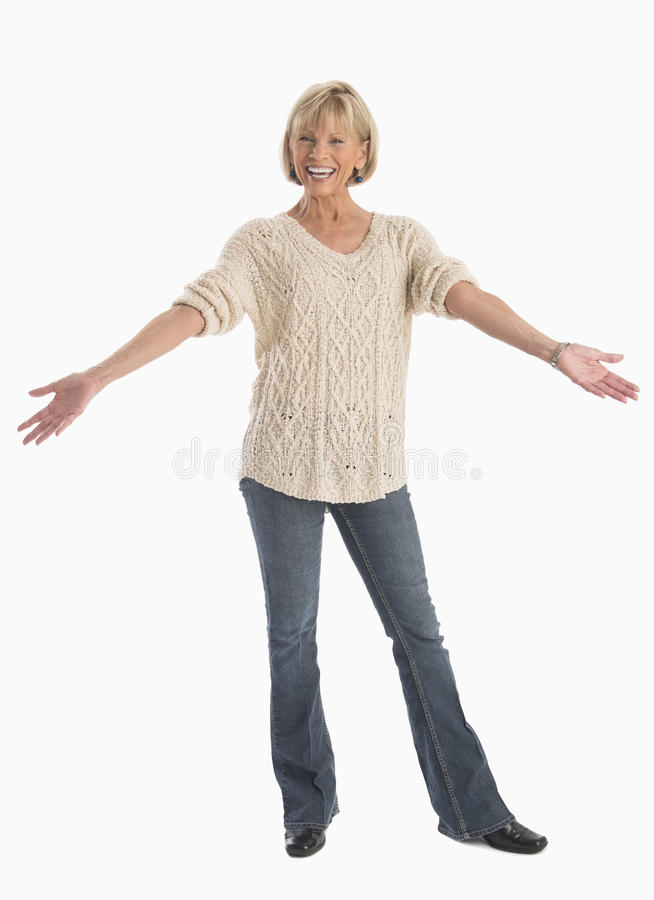Woman In Casuals With Arms Outstretched Over White Background royalty free stock photos