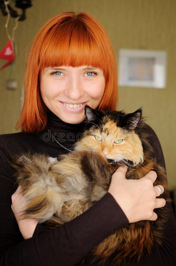 Woman with cat. Portrait of beautiful smiling woman with cat royalty free stock photos