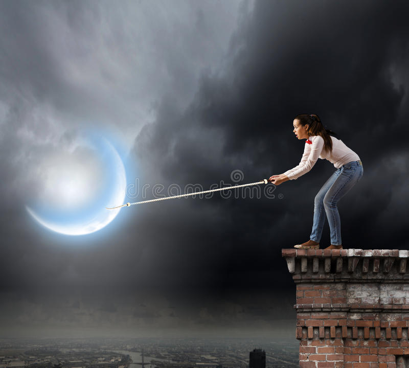 Woman catching moon royalty free stock photos