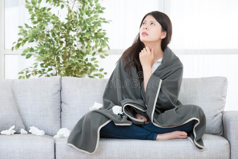 Woman Caught Cold feel throat painful. Sick Woman with Allergy reaction. Woman Caught Cold and Flu feel throat painful. medical and health concept. mixed race royalty free stock photos