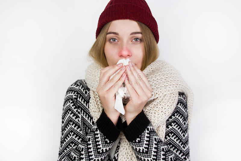 Woman Caught Cold. Sneezing into Tissue royalty free stock photos