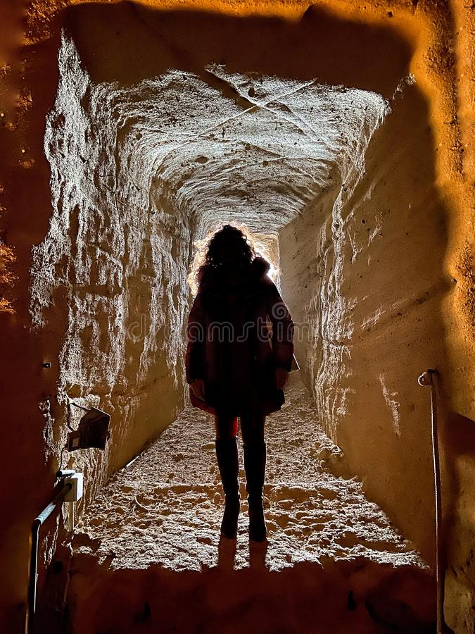 Woman in a cave stock images
