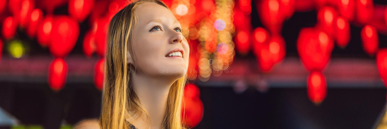 Woman celebrate Chinese New Year look at Chinese red lanterns BANNER, LONG FORMAT royalty free stock photos