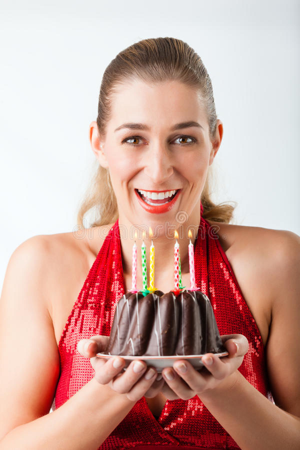Woman celebrating birthday with cake and candles stock photos