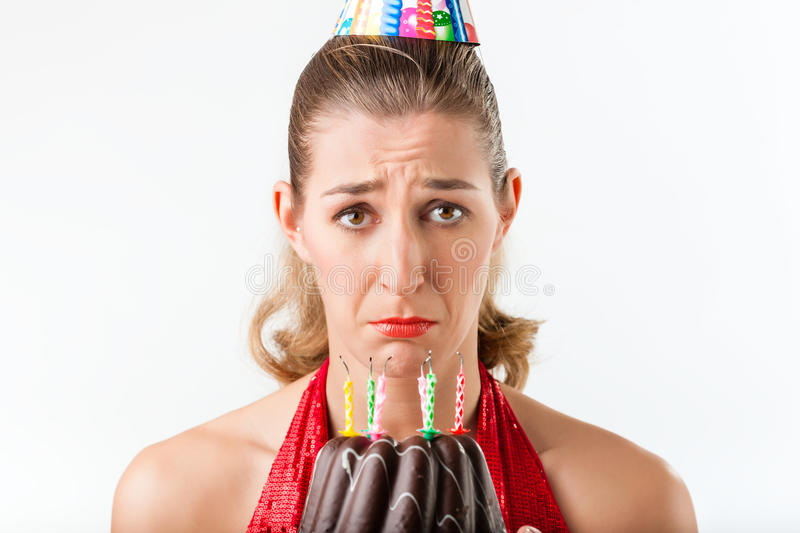 Woman celebrating birthday with cake candles wiped stock photo