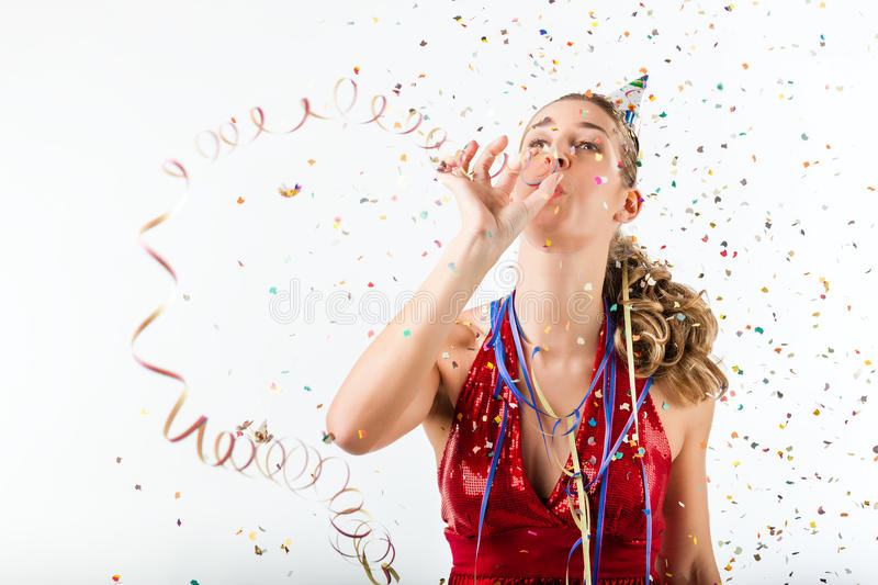 Woman celebrating birthday with streamer and party hat stock image