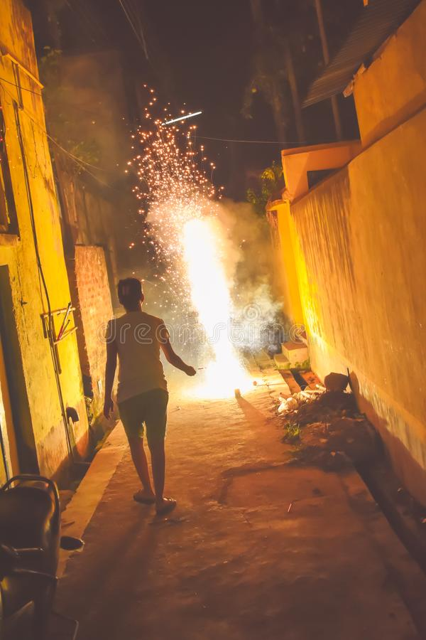 Woman celebrating firework party. Fun with fireworks stock image