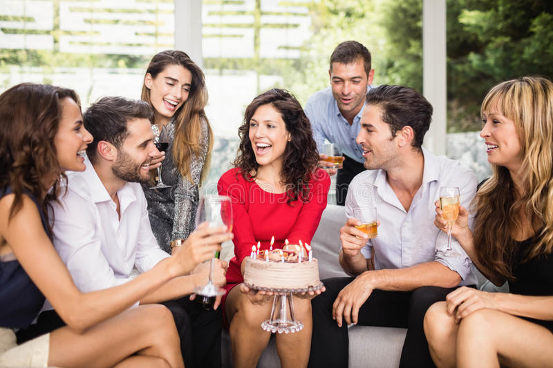 Woman celebrating her birthday with friends. Woman celebrating her birthday with group of friends stock images