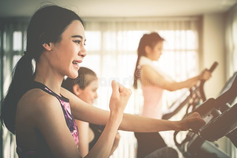 Woman is celebrating success in working out in fitness with friends stock photos