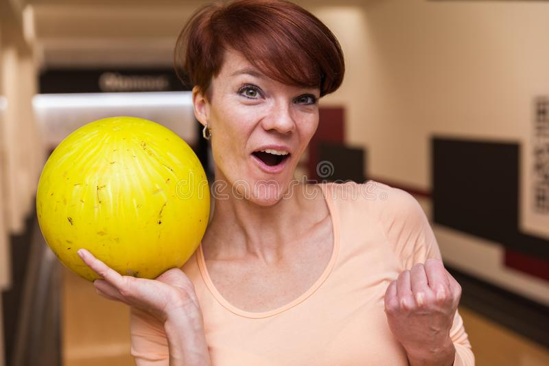 Woman celebrating victory in bowling. Young woman celebrating victory in bowling stock photos