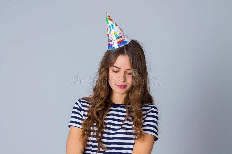 Woman in celebration cap looking down royalty free stock photos