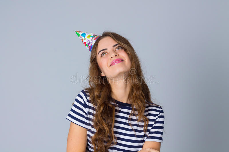 Woman in celebration cap looking down royalty free stock images