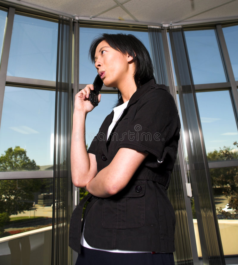 Woman and cell stock photos