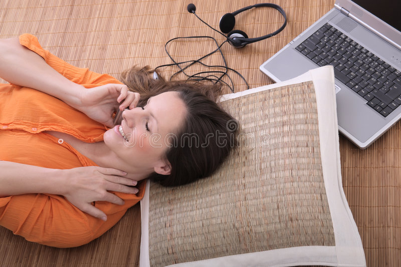 Woman on the cell phone. Beautiful young woman with laptop talking on the cell phone stock photos