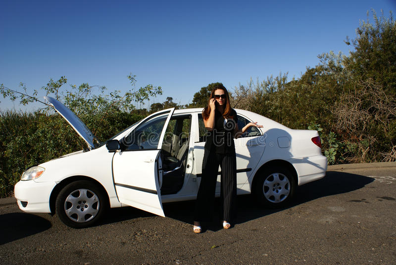 Download Woman On Cell Phone, Broken Car Royalty Free Stock Image - Image: 11040926