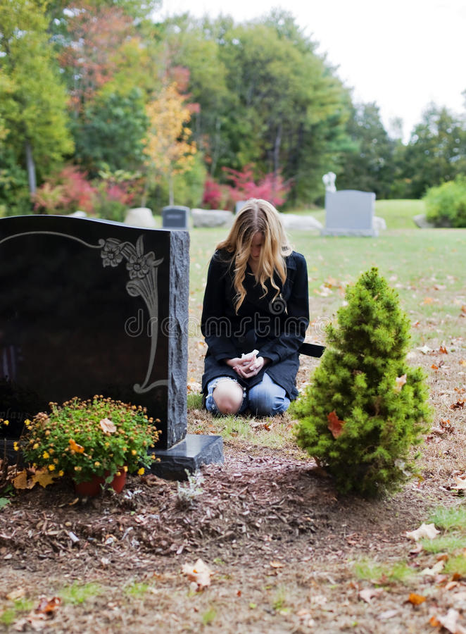 Woman in cemetery stock photo