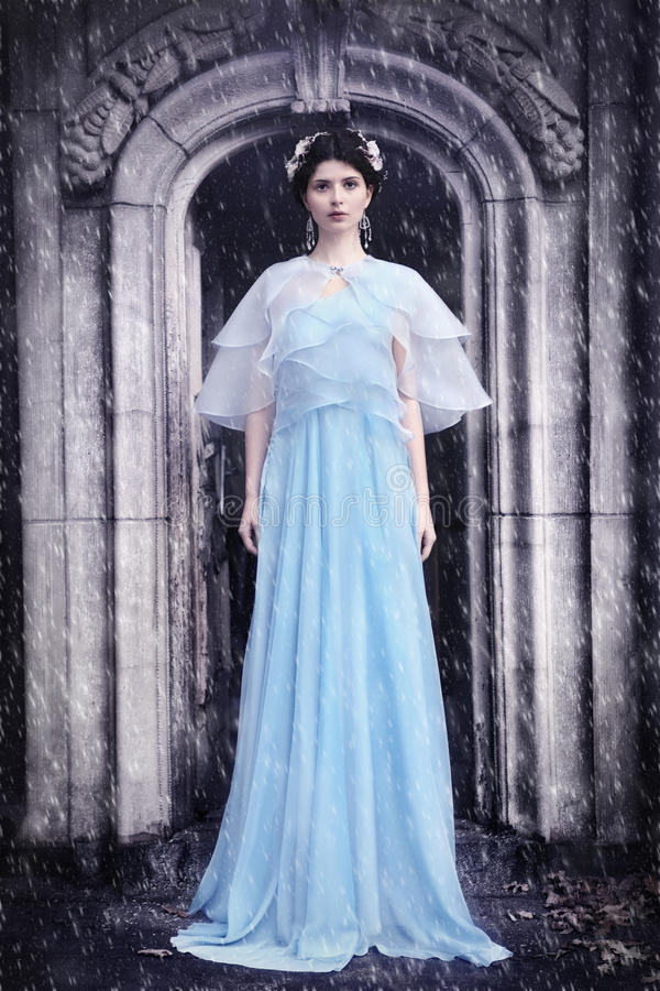 Woman in the cemetery - winter scenery. Woman in the cemetery - romantic gothic winter scenery, snowflakes falling stock photos