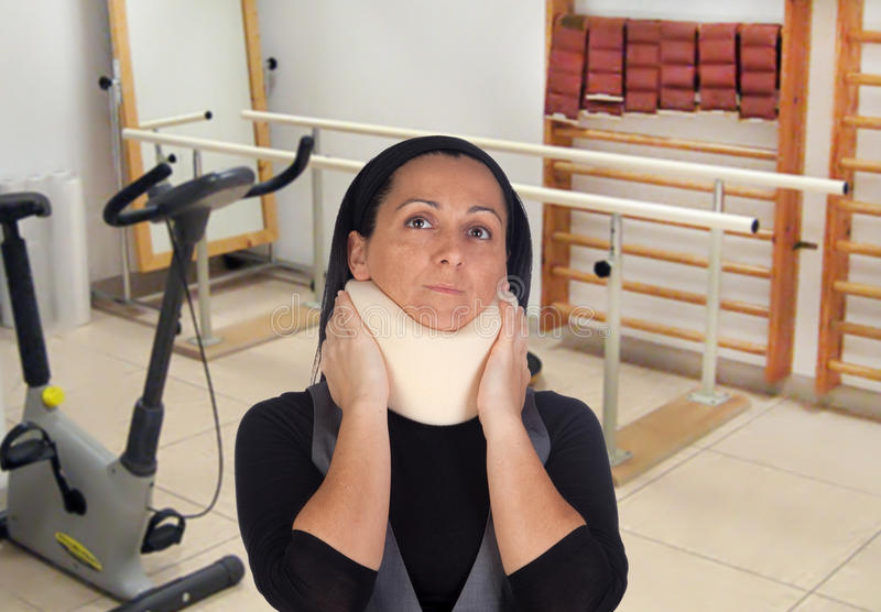 Woman with cervical collar. In rehabilitation room royalty free stock photos