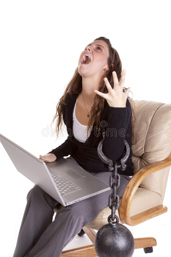 Woman chained to work stock photo