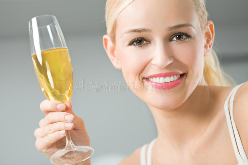Woman with champagne. Woman with glass of champagne stock photos