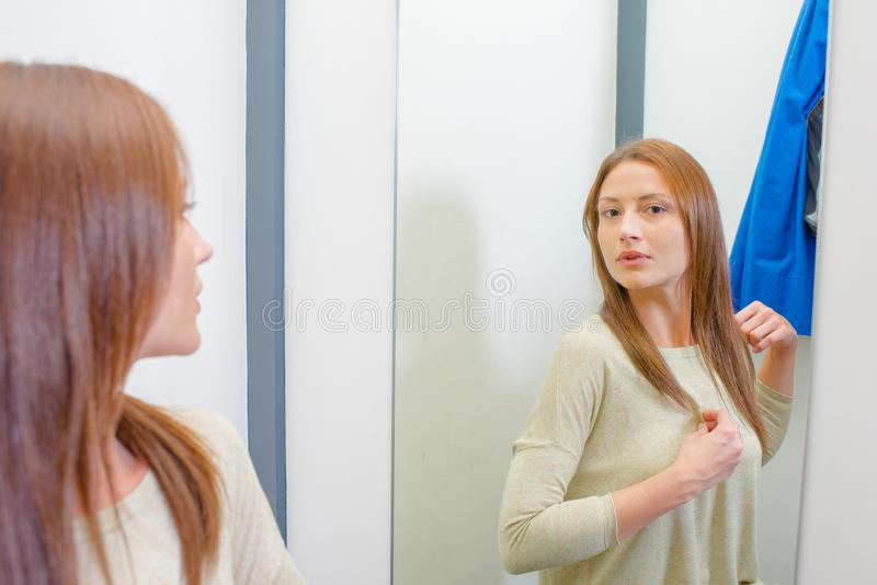 Woman in changing room royalty free stock image